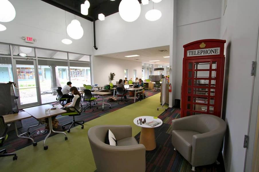 Link/Link Too office space with red phone booth and green carpet