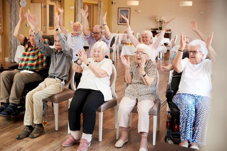 a group of seniors enjoy an event at a home
