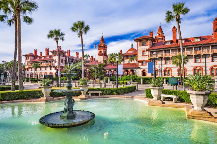 an old fountain in front of a historic building with ornate st. augustine architecture