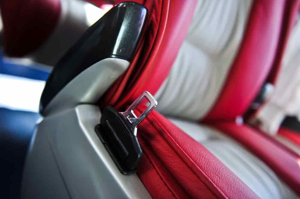 Red and gray charter bus seat with seat belt