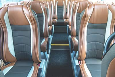 Tan and gray charter bus seats