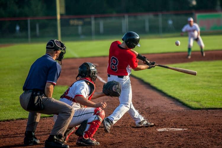 Baseball player swinging at a pitch
