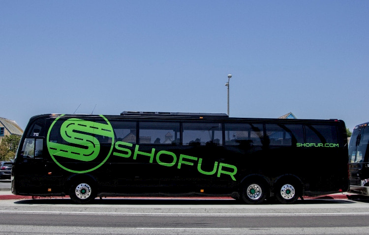 A Shofur charter bus driving on the road
