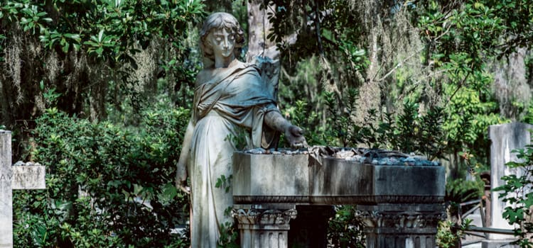 a gravestone in bonaventure cemetery carved to look like a young woman