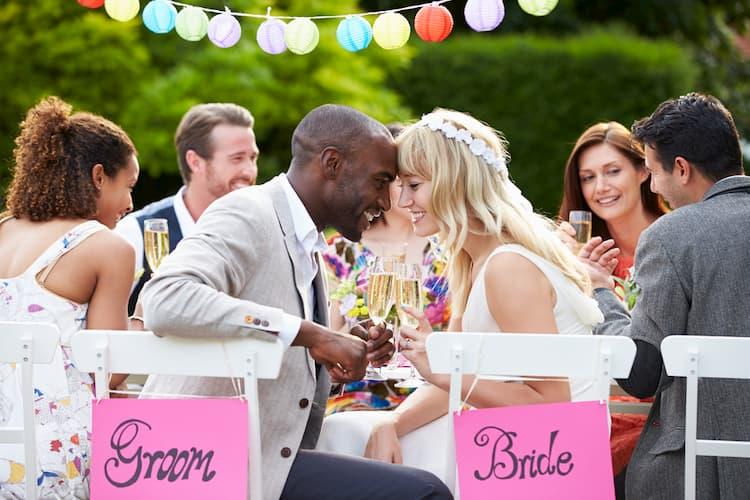 Bride and groom at outdoor wedding reception