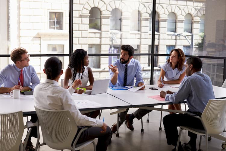 Coworkers gathered around conference table