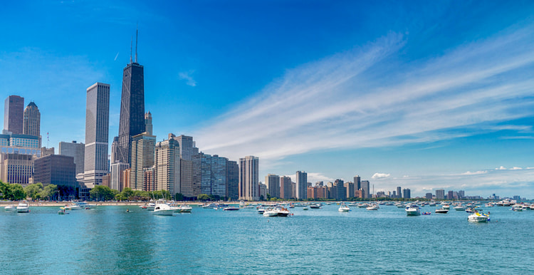 Chicago skyline and beach with boats on the water