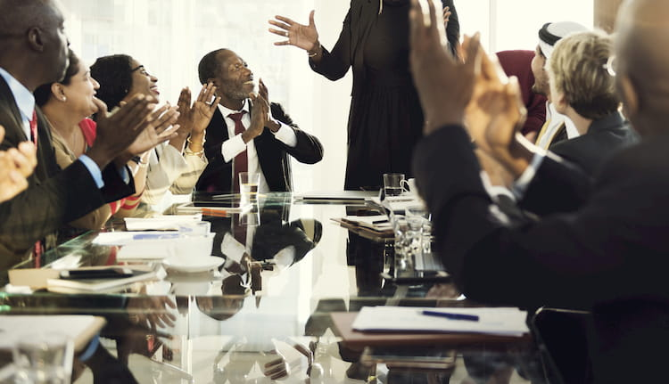 Professional business people clapping hands at corporate event
