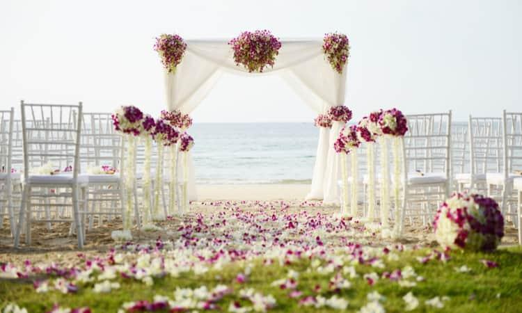 A wedding ceremony setup on the beach