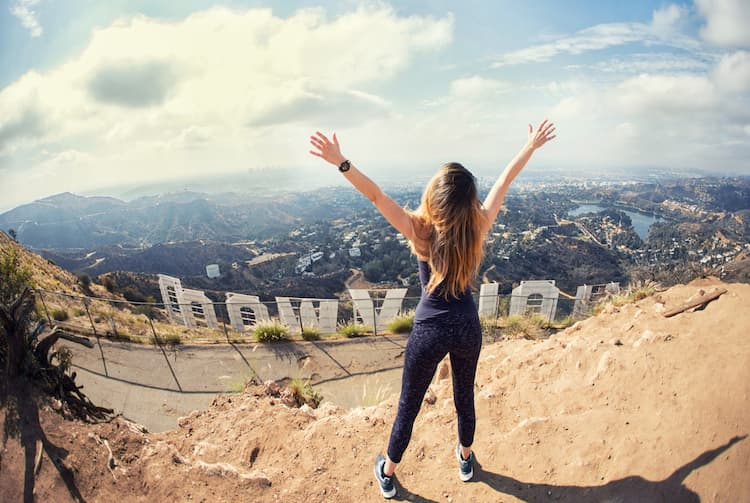 Young woman at the top of Hollywood sign
