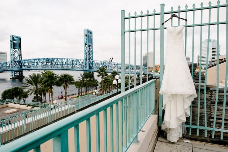 Wedding dress on patio overlooking Jacksonville skyline