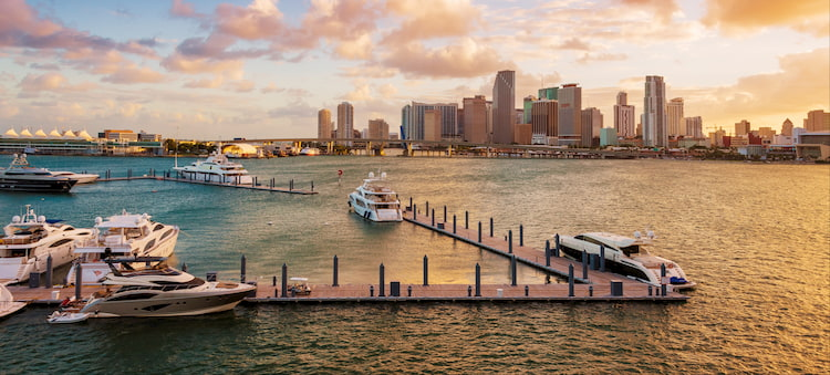 the downtown Miami skyline from a waterfront marina at dusk