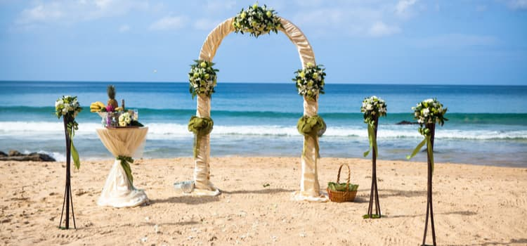 Wedding decorations on a beach.