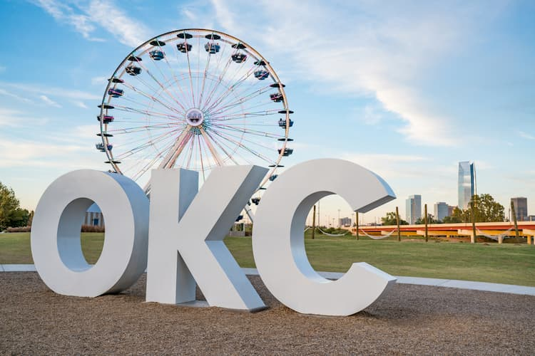 OKC sign in front of ferris wheel in Oklahoma City