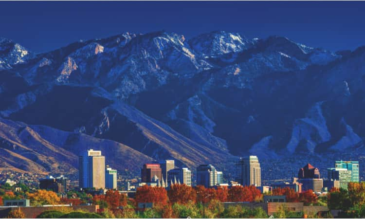 The Salt Lake City skyline backdropped by a mountain range