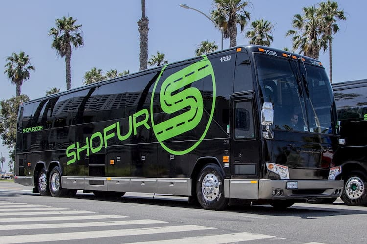 a charter bus from shofur prepares for departure in atlanta