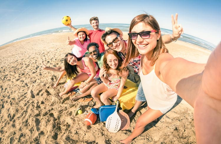 friends smile for a group selfie