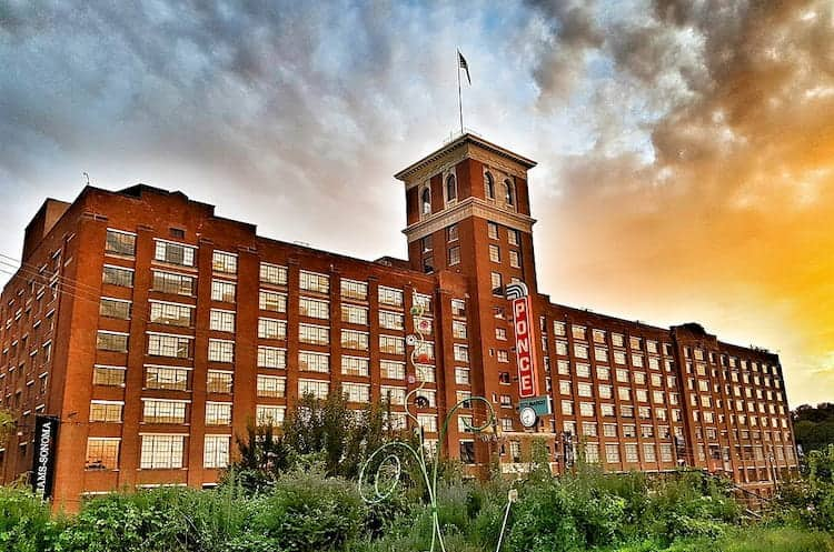 ponce city market's main building, with a sunset in the background