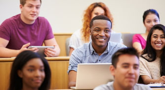 students smile in a college lecture hall