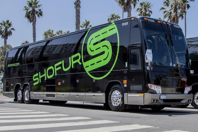 a charter bus from Shofur prepares to depart on a trip