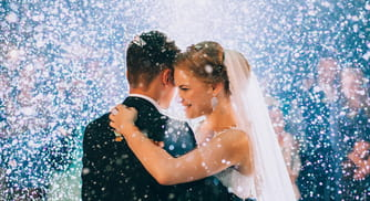 a couple celebrates their wedding with confetti