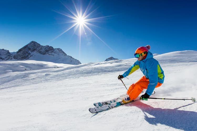 Skier racing down slope