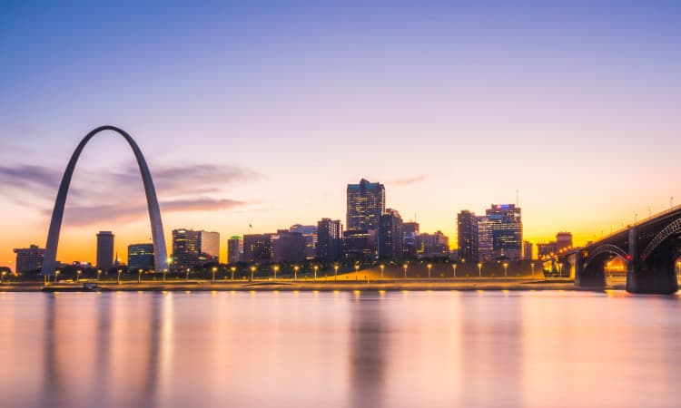 The sun sets over the St Louis skyline and riverfront